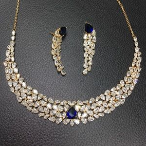 Gold plated set with blue stones